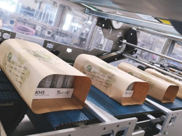 Wrapping of beverage and food cans in paper. Source: KHS GmbH
